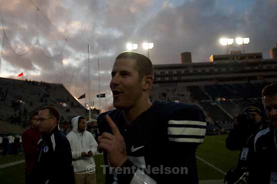 "BYU's Max Hall (15) says to the crowd, ""One more game,"" as he walks off the field following the win. BYU vs. Air Force college football Saturday, November 21 2009."