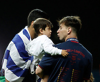 Calcio, finale di Champions League Juventus vs Barcellona all'Olympiastadion di Berlino, 6 giugno 2015.<br /> FC Barcelona's Lionel Messi holds his son Thiago in his arms at the end of the Champions League football final between Juventus Turin and FC Barcelona, at Berlin's Olympiastadion, 6 June 2015. Barcelona won 3-1.<br /> UPDATE IMAGES PRESS/Isabella Bonotto