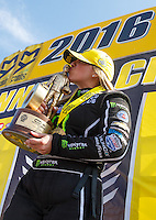 Mar 20, 2016; Gainesville, FL, USA; NHRA top fuel driver Brittany Force kisses the trophy as she celebrates after winning the Gatornationals at Auto Plus Raceway at Gainesville. Mandatory Credit: Mark J. Rebilas-USA TODAY Sports