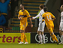 Motherwell's Michael Higdon celebrates after he scores Motherwell's fourth goal.