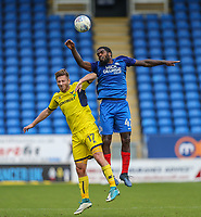 James Henry of Oxford United and Anthony Grant of Peterborough United in an aerial battle during the Sky Bet League 1 match between Peterborough and Oxford United at the ABAX Stadium, London Road, Peterborough, England on 30 September 2017. Photo by David Horn.