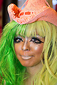 A female customer who has been transformed into a ganguro girl poses for pictures at the Ganguro Cafe &amp; Bar in the Shibuya shopping area on September 4, 2015. <br /> <br /> Ganguro is an alternative Japanese fashion trend which started in the mid-1990s where young women, rebelling against the traditional idea of Japanese beauty, wore colorful make-up and clothes and had dark-skin.<br /> <br /> 10 Ganguro fashion girls work in the new bar, which offers original Ganguro Balls (fried takoyaki style sausage balls in black squid ink batter) on its menu. Ganguro Caf&eacute; &amp; Bar also offers special services such as Ganguro make-up and the chance to take purikura (photo booth pictures) with staff and to look like a Ganguro girl walking around the Shibuya streets.<br /> <br /> The bar is popular with both Japanese and foreigners and has menus translated in English. (Photo by Rodrigo Reyes Marin/AFLO)