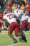 Luke Falk, Washington State University quarterback, hands off to Gerard Wicks in the rain during the Cougars first road test of the season against Big Ten foe Rutgers at High Point Solutions Stadium in Piscataway, New Jersey, on September 12, 2015.  WSU came back from a late deficit to go on a 90 yard touchdown drive to score the winning TD with 13 seconds left to get the win, 37-34.