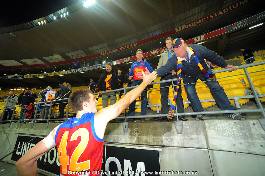 Justin Clarke celebrates with fans after the ANZAC Day AFL match between St Kilda Saints and Brisbane Lions at Westpac Stadium, Wellington, New Zealand on Friday, 25 April 2014. Photo: Dave Lintott / lintottphoto.co.nz