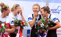 Canada's  Lindsay Jennerich, Patricia Obee (L) Silver Medal, New Zealand's Julia Edward, Louise Ayling (R) Gold Medal  celebrates on the podium after winning the Lightweight Women's Double Sculls final event of the World Rowing Championships in Amsterdam, Netherlands, Saturday August 30, 2014. - Photo by Paulo Amorim