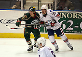February 24th 2008:  Petr Kalus (15) of the Houston Aeros skates up ice defended by Adam Taylor (32) during a game vs. the Rochester Amerks at Blue Cross Arena at the War Memorial in Rochester, NY.  The Aeros defeated the Amerks 4-0.   Photo copyright Mike Janes Photography 2008