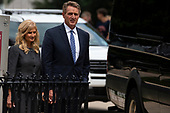 United States Senator Jeff Flake (Republican of Arizona) and his wife Cheryl look on as a hearse carrying the casket of late US Senator John McCain (Republican of Arizona) departs after a funeral service at the Washington National Cathedral in Washington, DC on September 1, 2018. <br /> Credit: Alex Edelman / CNP