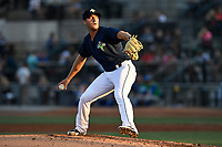 Starting pitcher Gary Cornish (23) of the Columbia Fireflies pitches directly into the setting sun in a game against the Lexington Legends on Thursday, June 8, 2017, at Spirit Communications Park in Columbia, South Carolina. Columbia won, 8-0, and Cornish go the win. (Tom Priddy/Four Seam Images)