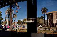 Phoenix, Arizona, March 27, 2010 - A view of the third rally of the 20-day Tea Party Express tour through a window on the steps of the Arizona capital. The tour which began in Searchlight, NV, hometown of Senate Majority Leader Harry Reid, will wind through the United States ending up in Washington, D.C. on April 15 for a tax day rally. ..