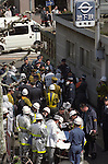 Victims await treatment in the street outside Tsujiki Subway Station in Tokyo on March 20, 1995. At around 8.00am in the morning members of the Aum Shirikyo Doomsday Cult released poisonous Sarin Gas in five coordinated attacks on trains travelling through Kasumigaseki and Nagatacho stations. This resulted in the death of 13 passengers and staff and over 6,000 injuries and was Japan's deadliest act of domestic terrorism.  (Photo by Yomiuri Newspaper/AFLO)