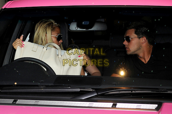 Katie Price (Jordan) & Leandro Penna leaving the Soho Hotel, London, England..August 2nd, 2011.pink range rover car half length door open sunglasses shades profile sitting couple white bag.CAP/IA.©Ian Allis/Capital Pictures.