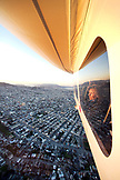 USA, California, San Francisco, woman looking out the window of the Airship Ventures Zeppelin, San Fracisco looking north