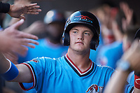 Josh Jung (15) of the Hickory Crawdads high fives teammates after scoring a run during the game against the Charleston RiverDogs at L.P. Frans Stadium on August 10, 2019 in Hickory, North Carolina. The RiverDogs defeated the Crawdads 10-9. (Brian Westerholt/Four Seam Images)