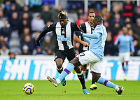 30th November 2019; St James Park, Newcastle, Tyne and Wear, England; English Premier League Football, Newcastle United versus Manchester City; Allan Saint-Maximin of Newcastle United beats the challenge from Benjamin Mendy of Manchester City - Strictly Editorial Use Only. No use with unauthorized audio, video, data, fixture lists, club/league logos or 'live' services. Online in-match use limited to 120 images, no video emulation. No use in betting, games or single club/league/player publications