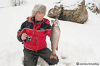 Man with brook trout