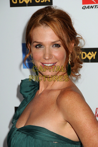 POPPY MONTGOMERY.G-Day USA: Australia Week 2009 Black Tie Gala at the Hollywood & Highland Grand Ballroom, Hollywood, California, USA..January 18th, 2009.headshot portrait dangling black earrings  green one shoulder .CAP/ADM/BP.©Byron Purvis/AdMedia/Capital Pictures.