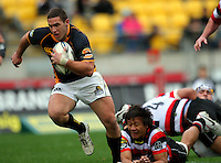 Shaun Treeby beats the tackle of Counties Manukau fullback Tim Nanai-Williams. ITM Cup - Wellington Lions v Counties-Manukau Steelers at Westpac Stadium, Wellington, New Zealand on Sunday, 8 August 2010. Photo: Dave Lintott/lintottphoto.co.nz.