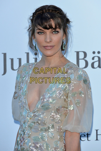 Milla Jovovich.amfAR 20th Cinema Against Aids Gala at the Hotel du Cap, Antibes, during the 66th Cannes Film Festival, France 23rd May 2013..half length headshot plait hair braid up fringe white silver dress ruffles tiered sleeves sheer gold silver low cut .CAP/PL.©Phil Loftus/Capital Pictures.