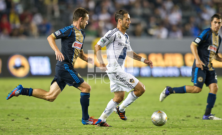CARSON, CA - July 4, 2012: Philadelphia Union forward Jack McInerney (9) and LA Galaxy midfielder Marcelo Servas (8) during the LA Galaxy vs Philadelphia Union match at the Home Depot Center in Carson, California. Final score LA Galaxy 1, Philadelphia Union 2.
