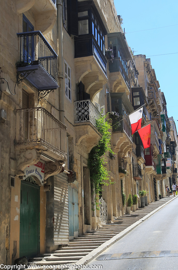 Traditional balconies of historic buildings in city centre, Valletta, Malta