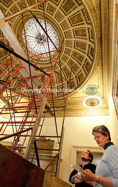 Naugatuck, CT-02 April 2012-040212CM02-  Library Director Jocelyn L. Miller and Children's Librarian, Matthew Yanarella explain the Rotunda Restoration project, inside the Howard Whittemore Memorial Library Monday afternoon in Naugatuck.  The project, which began yesterday, includes cleaning the skylight inside the lobby, restoring the laylight and remodeling the library's bathroom.   Funding was provided by The Connecticut State Library, the Salem Foundation Fund at the Connecticut Community Foundation and many local residents and businesses, said Miller.  The work is being done by Crocker Architectural Sheet Metal from North Oxford, MA, who specializes in historical restoration.  The work is expected to be completed by August.   Christopher Massa Republican-American