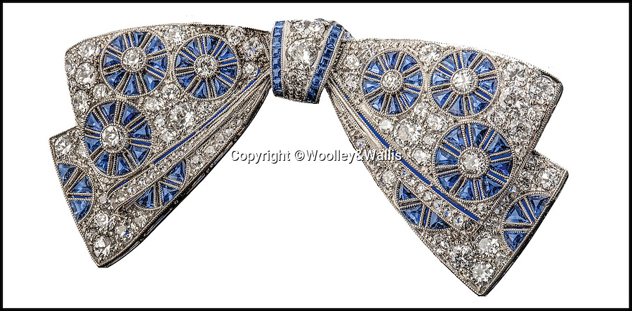 BNPS.co.uk (01202 558833)<br /> Pic: Woolley&Wallis/BNPS<br /> <br /> A stunning diamond and sapphire brooch owned by Princess Margaret for most of her life is expected to sell for £18,000.<br /> <br /> The beautiful piece of jewellery was owned by the Queen's sister from at least 1948 up until her death in 2002.<br /> <br /> The early Art Deco pavé-set diamond bow was made in about 1920 and is about 2 inches wide.<br /> <br /> Although it is an exquisite piece, it is the fact it belonged to the princess that quadruples the value.<br /> <br /> It will be sold by Woolley & Wallis in Salisbury, Wiltshire, on April 28.
