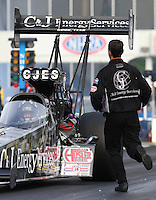 May 15, 2015; Commerce, GA, USA; A crew member running to NHRA top fuel driver Larry Dixon during qualifying for the Southern Nationals at Atlanta Dragway. Mandatory Credit: Mark J. Rebilas-USA TODAY Sports