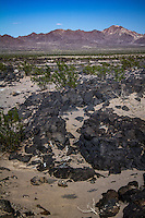 "Amboy Crater and Lava Field is an extinct volcano that rises above a 27 sq mi. lava field in southern California. They are located in the Mojave Desert 2.5 miles southwest of historic U.S. Route 66, near the town of Amboy, California.  Amboy Crater and Lava Field were designated the ""Amboy Crater National Natural Landmark"" in May, 1973."