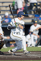 Michigan Wolverines first baseman Jake Bivens (18) follows through on his swing against the Central Michigan Chippewas on May 9, 2017 at Ray Fisher Stadium in Ann Arbor, Michigan. Michigan defeated Central Michigan 4-2. (Andrew Woolley/Four Seam Images)