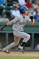 Shortstop Emerson Jimenez (14) of the Asheville Tourists bats in a game against the Greenville Drive on Tuesday, July 1, 2014, at Fluor Field at the West End in Greenville, South Carolina. Asheville won, 5-2. (Tom Priddy/Four Seam Images)