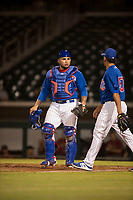 AZL Cubs 1 catcher Alexander Guerra (6) talks to relief pitcher Fernando Calderon (57) during an Arizona League game against the AZL Diamondbacks at Sloan Park on June 18, 2018 in Mesa, Arizona. AZL Diamondbacks defeated AZL Cubs 1 7-0. (Zachary Lucy/Four Seam Images)