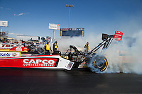 Mar 30, 2014; Las Vegas, NV, USA; NHRA top fuel driver Steve Torrence (near lane) burns out alongside Doug Kalitta during the Summitracing.com Nationals at The Strip at Las Vegas Motor Speedway. Mandatory Credit: Mark J. Rebilas-
