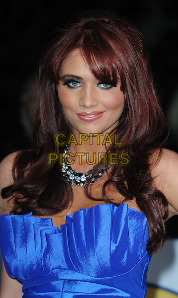 AMY CHILDS.The British Comedy Awards 2011at Indigo, The O2 Arena, London.England, UK..January 22nd, 2011.arrivals headshot portrait bangs fringe smiling make-up blue strapless necklace bustier .CAP/WIZ.© Wizard/Capital Pictures.