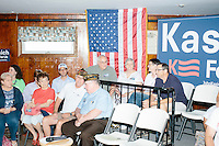 People wait for the arrival of Republican presidential candidate and Ohio governor John Kasich at a town hall campaign event at the Derry VFW in Derry, New Hampshire.