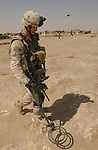Sgt. Matt Reese, from Coffeeville, Kan., searches for mines and unexploded ordnance in Tall Afar, Iraq, during an operation called Sykes Hammer on Aug. 1, 2004. Three battalions from the 3rd Brigade, 2nd Infantry Division (Stryker Brigade Combat Team) and three Iraqi National Guard battalions conducted Sykes Hammer in an effort to seize weapons and detain anti-Iraqi forces. Reese is a member of Company B, 5th Battalion, 20th Infantry Regiment. (U.S. Army photo by Sgt. Fred Minnick)