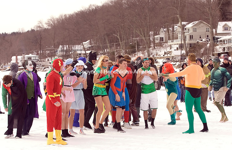 Winsted, CT-30, January 2010-012710CM04  Matt Smith of Winsted (right and dressed as Aquaman) gets his team ready for the 7th annual Penguin Plunge Saturday morning at Highland Lake in Winsted.  His team, named the Highland Lake Super Heroes, raised approximately 18,000 dollars for this event, which goes to the Special Olympics.      --Christopher Massa Republican-American