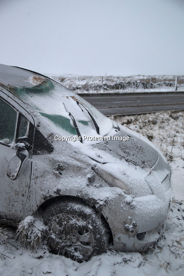 14/01/16<br /> <br /> A car is abandoned after rolling over when it slid off the road near Flash Derbyshire Peak District near Buxton.<br /> <br /> All Rights Reserved: F Stop Press Ltd. +44(0)1335 418365   +44 (0)7765 242650 www.fstoppress.com