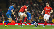 17th March 2018, Principality Stadium, Cardiff, Wales; NatWest Six Nations rugby, Wales versus France; Leigh Halfpenny of Wales is tackled by Mathieu Bastareaud of France