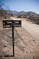 Sign at head of Tunnel trail with burnt landscape in background from Jesusita fire, Santa Barbara, California. May 2009