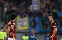 Calcio, Serie A: Roma vs Inter. Roma, stadio Olimpico, 19 marzo 2016.<br /> Roma's Mohamed Salah, left, and Miralem Pjanic react after FC Inter scored during the Italian Serie A football match between Roma and FC Inter at Rome's Olympic stadium, 19 March 2016. The game ended 1-1.<br /> UPDATE IMAGES PRESS/Riccardo De Luca