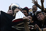 14 November 2004: United captain Ryan Nelsen (center) celebrates with the Alan I. Rothenberg Trophy and DC's fans. DC United defeated the Kansas City Wizards 3-2 to win MLS Cup 2004, Major League Soccer's championship game at the Home Depot Center in Carson, CA..