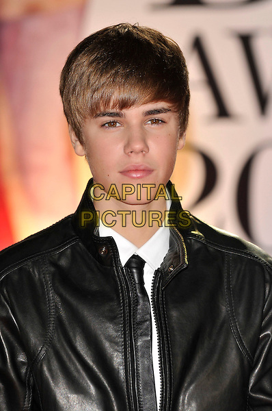 JUSTIN BIEBER .The BRIT Awards 2011 - Arrivals at the O2 Arena, London, England, UK, .February 15th, 2011..brits portrait headshot black  leather jacket white shirt tie .CAP/PL.©Phil Loftus/Capital Pictures.
