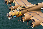 The Boeing B-17G Flying Fortress Nine-O-Nine flies low over the Atlantic Ocean off the coast of Daytona Beach, Florida, Wednesday, March 12, 1997.(Brian Myrick)