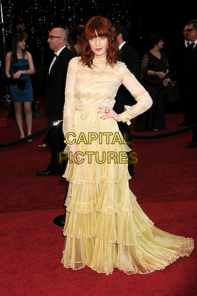 FLORENCE WELCH of Florence And The Machine in Valentino .83rd Annual Academy Awards - Arrivals held at the Kodak Theatre,  Hollywood, California, USA, 27th February 2011..oscars full length yellow ruffles ruffle long sleeve maxi dress  lace beige tiered hand on hip .CAP/ADM/BP.©Byron Purvis/AdMedia/Capital Pictures.