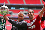 LONDON, ENGLAND - MAY 12: Matty Blair and Gary Mills of York City celebrate with the trophy after winning the FA Trophy Final match between York City and Newport County at Wembley Stadium on May 12, 2012 in London, England.  (Photo by Dave Horn - Extreme Aperture Photography)