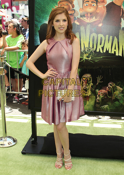 "Anna Kendrick.""ParaNorman"" Los Angeles Premiere held at AMC CityWalk Stadium 19 Theatre, Universal City, California, USA..August 5th, 2012.full length pink sleeveless dress silk satin hand on hip clutch bag white strappy sandals.CAP/ADM/RE.©Russ Elliot/AdMedia/Capital Pictures."