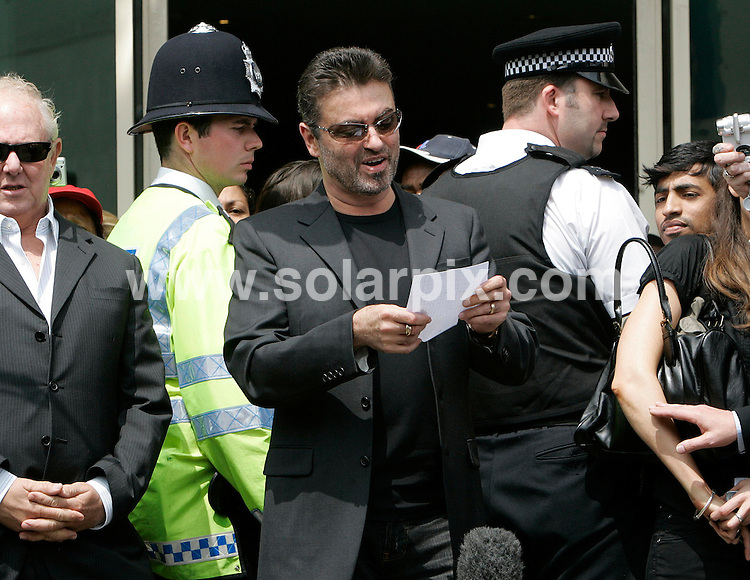 **ALL ROUND PICTURES FROM SOLARPIX.COM**.**NO UK NEWSPAPER PUBLICATION **UK MAGAZINE PUBLICATION ONLY** AND NO PUBLICATION IN FRANCE, SCANDINAVIA, AUSTRALIA AND GERMANY** .Singer George Michael is pictured leaving Brent Magistrates in London today where he was sentenced to 100 hours community service and banned from driving for two years after being caught at the wheel of his car under the influence of drugs.JOB REF:  4052    SFE       DATE: 08.06.07.**MUST CREDIT SOLARPIX.COM OR DOUBLE FEE WILL BE CHARGED* *UNDER NO CIRCUMSTANCES IS THIS IMAGE TO BE REPRODUCED FOR ANY ONLINE EDITION WITHOUT PRIOR PERMISSION*
