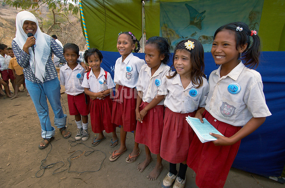 Girls participate in a quiz about conservation, Komodo Village, Komodo National Park