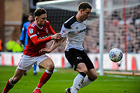 Derby County's defender Craig Forsyth (3) holds offf Nottingham Forest's midfielder Matty Cash (14) during the Sky Bet Championship match between Nottingham Forest and Derby County at the City Ground, Nottingham, England on 10 March 2018. Photo by Stephen Buckley / PRiME Media Images.