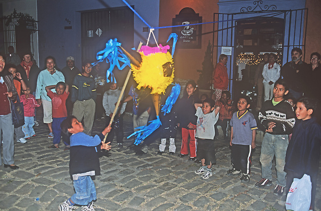 Children Hitting Pinata, Oaxaca City, Oaxaca, Mexico